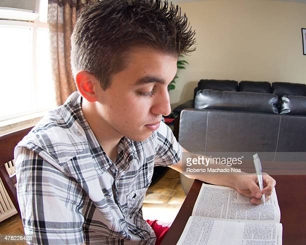 Christian Daily Devotional Portrait of the teen boy studying the Bible in the room