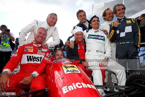 Christian Danner Riccardo Patrese Gerhard Berger Niki Lauda Jean Alesi Nelson Piquet Pierluigi Martini and Alain Prost pose on track after qualifying...