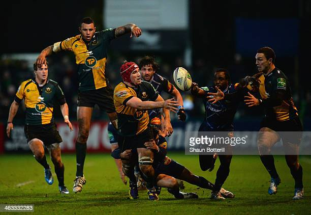 Christian Day of Northampton Saints paases the ball out to teammate George North during the Heineken Cup Pool 1 Round 6 match between Northampton...