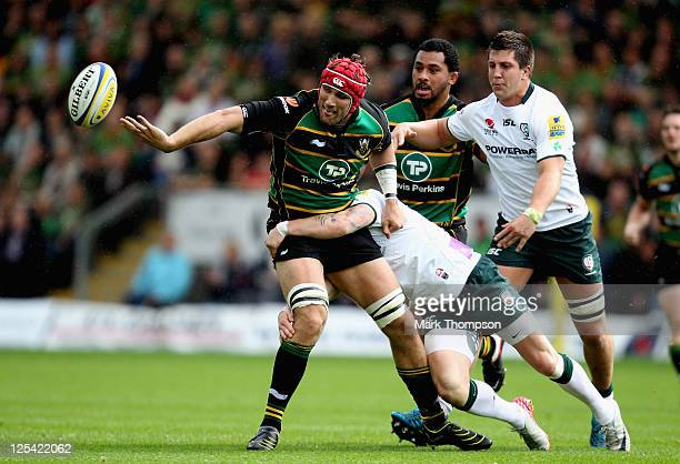 Christian Day of Northampton Saints tangles with Jon Clarke of London Irish during the AVIVA Premiership match between Northampton Saints and London...