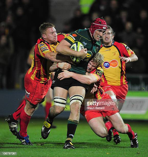 Christian Day of Northampton Saints tries to break through the Newport Gwent Dragons defense during the LV Anglo Welsh Cup match at Franklin's...