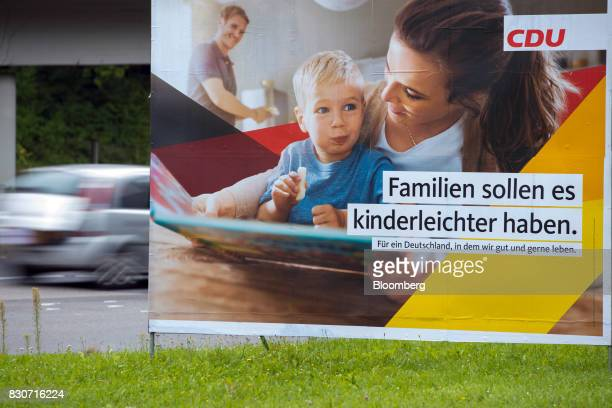 A Christian Democratic Union election billboard stands in Dortmund Germany on Saturday Aug 12 2017 Angela Merkel Germany's chancellor and leader of...