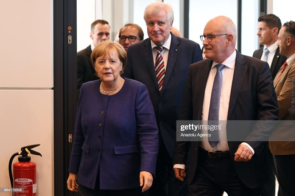 Christian Democrats (CDU) Bundestag faction leader Volker Kauder (R), German Chancellor Angela Merkel (L) and Bavarian Governor and head of the Bavarian Christian Social Union (CSU) Horst Seehofer attends the first faction meeting of the Christian Democrats party at the German federal parliament, Bundestag, in the Reichstag building in Berlin, Germany on September 26, 2017.