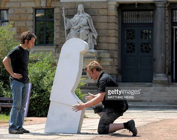 Christian Demuth and Johannes Koehler install a symbolic knife on July 1 2010 in Dresden eastern Germany to commemorate the murder of a pregnant...