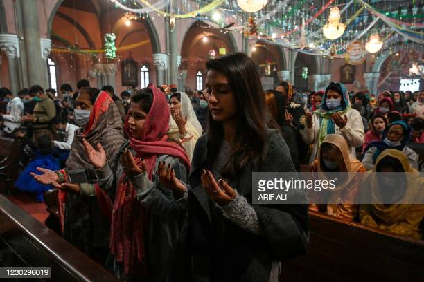 Christian devotees attend a prayer service on Christmas Day at theSacred Heart Cathedral, in Lahore on December 25, 2020.