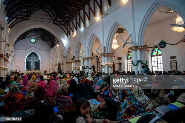 Christian devotees attend a prayer service on Christmas Day at the Saint John Cathedral, in Peshawar on December 25, 2020.