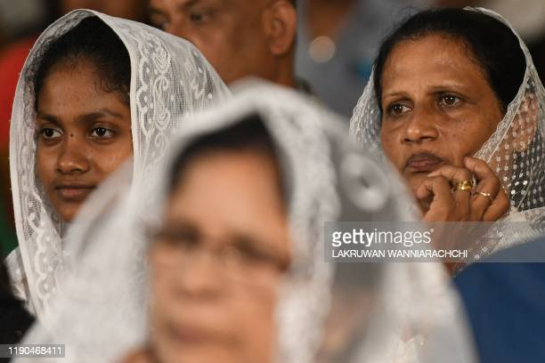 Christian devotees attend midnight mass at St Sebastian's Church in Negombo on December 24 2019 Archbishop of Colombo Malcolm Ranjith attended St...