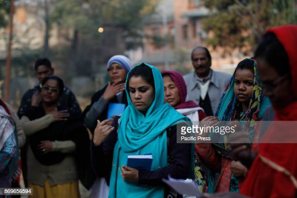 Christian devotees pras on the commemoration of All Souls Day in a local cemetery in Srinagar the summer capital of Indian controlled Kashmir All...