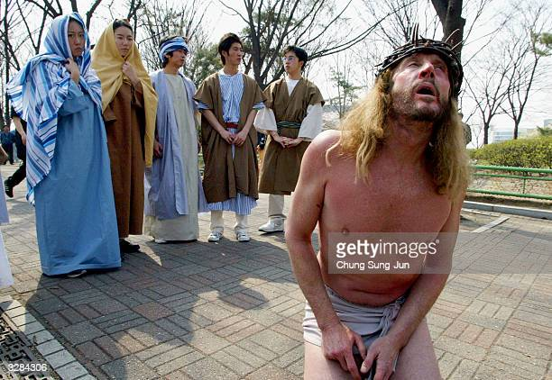 Christian devotees reenact Jesus' last walk up Golgotha Hill in a downtown park on Good Friday April 9 2004 in Seoul South Korea Christians around...