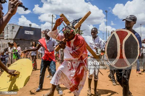 Christian devotees reenact the Way of the Cross or Jesus Christ's passion during a Good Friday commemoration in the Kibera slum of Nairobi on April...