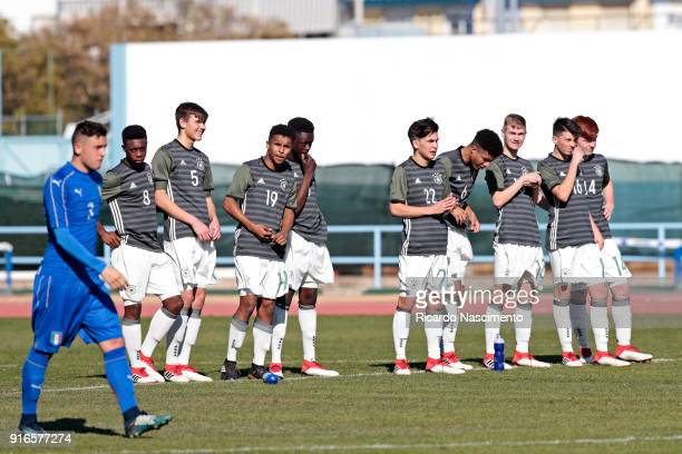 Christian Dimarco of Italy U16 walks to take a penalty while players of Germany U16 Christopher Scott Fynn Otto KarimDavid Adeyemi Ware Pakia...