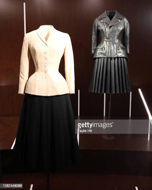 """Christian Dior bar suit and a 2011 Junya Watanabe ensemble are on display at the press preview for the Costume Institute's annual exhibition """"About..."""