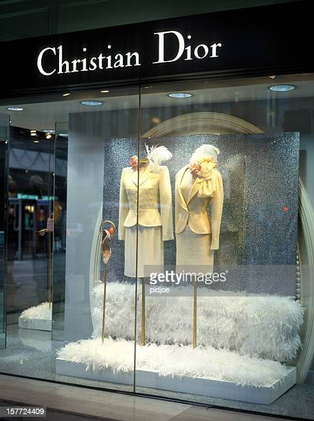 christian dior window display on nathan road kowloon hong kong - christian dior designer label stock pictures, royalty-free photos & images