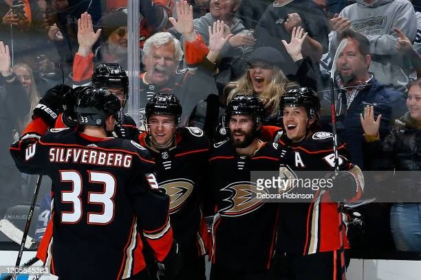 Christian Djoos, Adam Henrique, Rickard Rakell, and Jakob Silfverberg of the Anaheim Ducks celebrate Henrique's third period goal during the game...