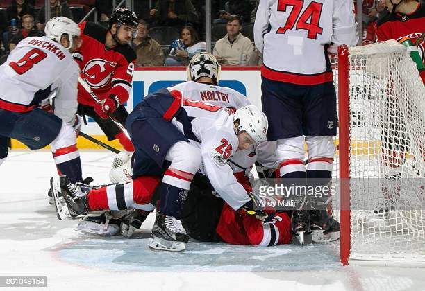 Christian Djoos of the Washington Capitals is called for interference  against Nico Hischier of the New 9091822de