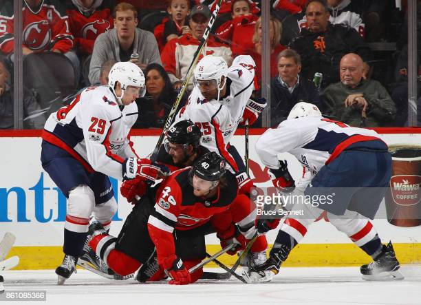 Christian Djoos of the Washington Capitals pushes Blake Coleman of the New  Jersey Devils to the fa656dd91