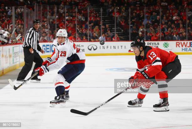 Christian Djoos of the Washington Capitals skates against Nico Hischier of  the New Jersey Devils at a9cba873e