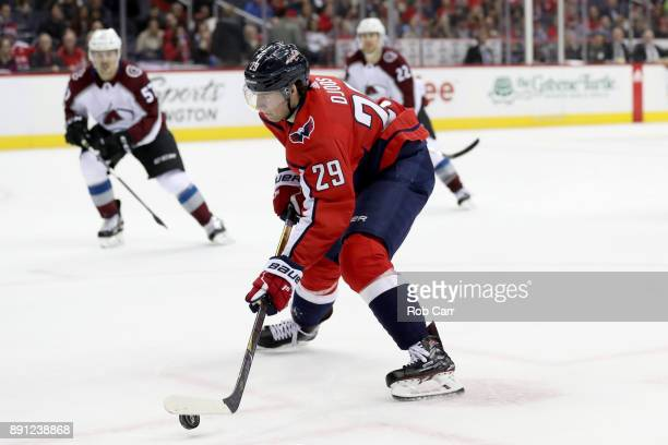 Christian Djoos of the Washington Capitals takes a shot on goal against the Colorado Avalanche in the second period at Capital One Arena on December...