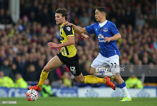 Christian Doidge of Dagenham and Redbridge and Steven Pienaar of Everton compete for the ball during the Emirates FA Cup third round match between...