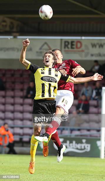 Christian Doidge of Dagenham Redbridge attempts to head the ball under pressure from Rod McDonald of Northampton Town during the Sky Bet League Two...