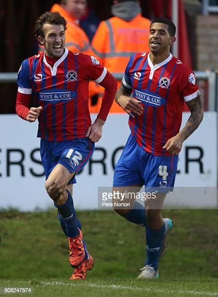 Christian Doidge of Dagenham Redbridge celebrates after scoring his sides goal during the Sky Bet League Two match between Dagenham Redbridge and...