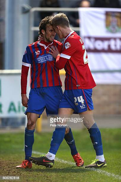 Christian Doidge of Dagenham Redbridge celebrates with team mate Joe Worrall after scoring his sides goal during the Sky Bet League Two match between...