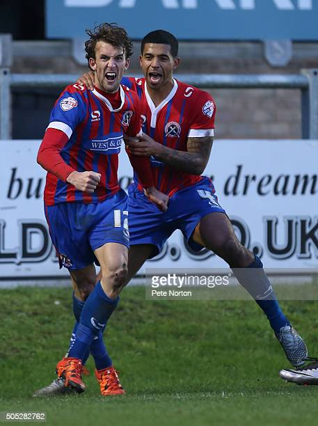 Christian Doidge of Dagenham Redbridge celebrates with team mate Joss Labadie after scoring his sides goal during the Sky Bet League Two match...