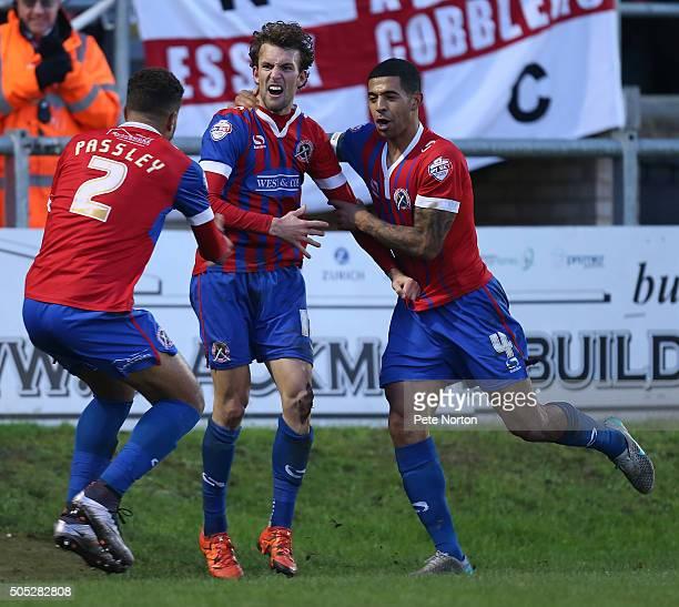 Christian Doidge of Dagenham Redbridge celebrates with team mates Joss Labadie and Josh Passley after scoring his sides goal during the Sky Bet...