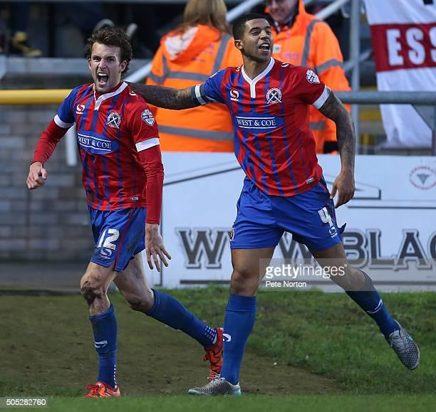 Christian Doidge of Dagenham Redbridge celebrates with teamamate Joss Labadie after scoring his sides goal during the Sky Bet League Two match...