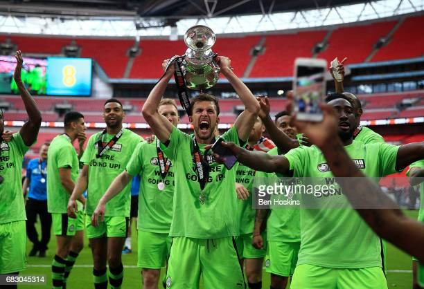 Christian Doidge of Forest Green celerbates with the trophy follwoing the Vanarama National League Play Off Final between Tranmere and Forest Green...
