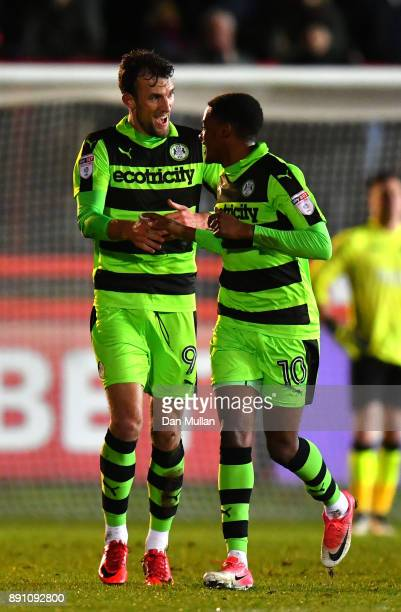 Christian Doidge of Forest Green Rovers celebrates after scoring his sides first goal with Reece Brown of Forest Green Rovers during the Emirates FA...