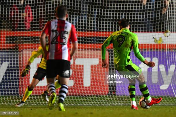 Christian Doidge of Forest Green Rovers scores a penalty during the Emirates FA Cup Second Round Replay between Exeter City and Forest Green at St...