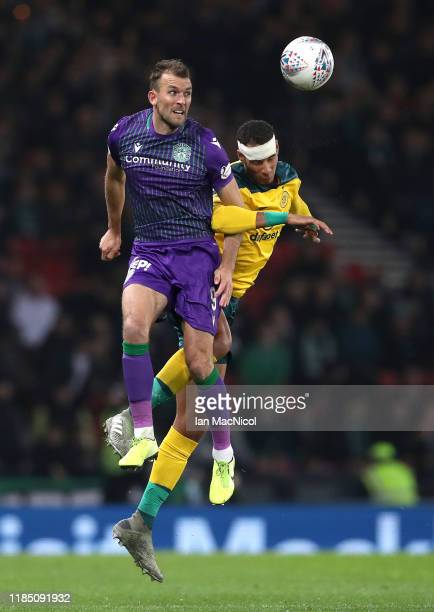 Christian Doidge of Hibernian battles for possession with Christopher Jullien of Celtic during the Betfred Cup Semi-Final match between Hibernan and...