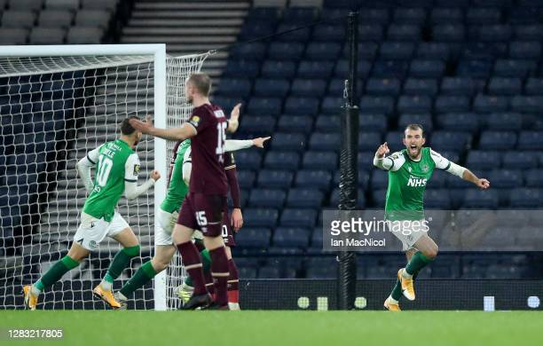 Christian Doidge of Hibernian FC celebrates after scoring his team's first goal during the William Hill Scottish Cup first semi-final match between...