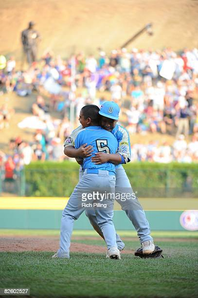 Christian Donahue of the Waipio LIttle League team is greeted by a teammate after winning the World Series Championship game against the Matamoros...