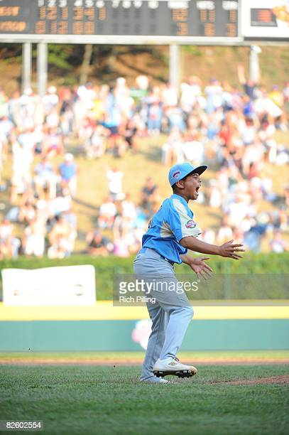 Christian Donahue of the Waipio LIttle League team leaps for joy after winning the World Series Championship game against the Matamoros Little League...