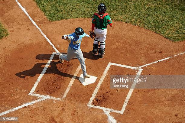 Christian Donahue of the Waipio Little League team scores a run during the World Series Championship game against the Matamoros Little League team at...