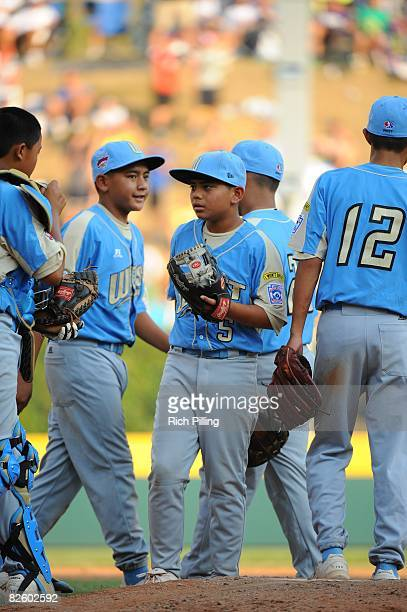 Christian Donahue of the Waipio LIttle League team stands on the mound with teammates during the World Series Championship game against the Matamoros...