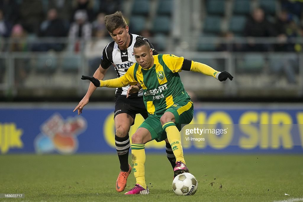 Christian Dorda of Heracles Almelo, Tjaronn Chery of ADO Den Haag during the Dutch Eredivisie match between ADO Den Haag and Heracles Almelo at the Kyocera Stadium on march 03, 2013 in The Hague, The Netherlands