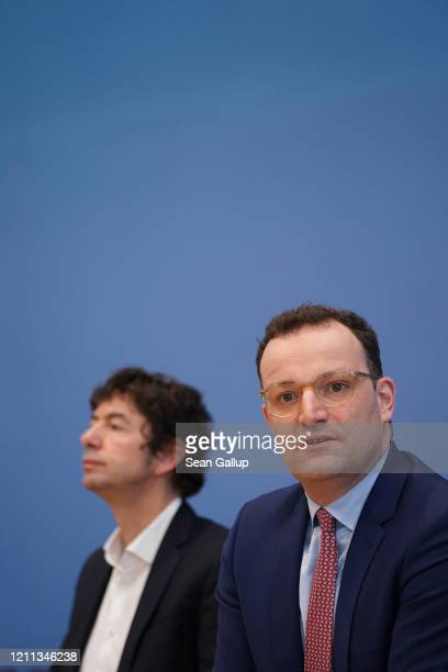 Christian Drosten Director of the Institute for Virology at Charite Berlin hospital and Jens Spahn German Health Minister speak to the media over the...