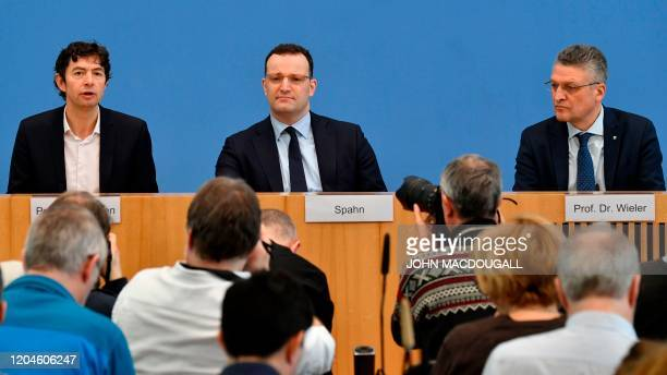 Christian Drosten director of the Institute of Virology at Berlin's Charite hospital German Health Minister Jens Spahn and Lothar Wieler President of...