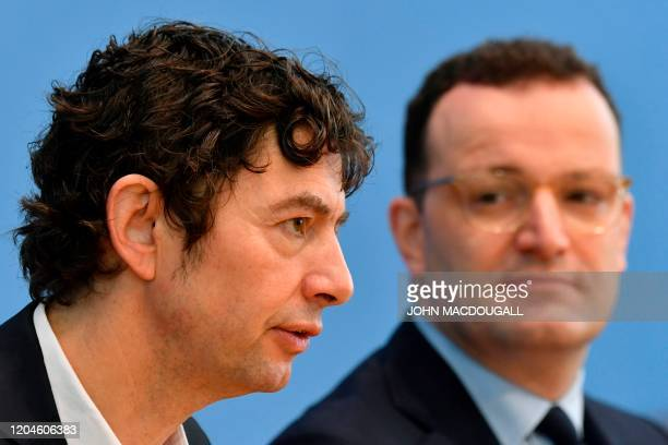 Christian Drosten director of the Institute of Virology at Berlin's Charite hospital and German Health Minister Jens Spahn give a press conference in...