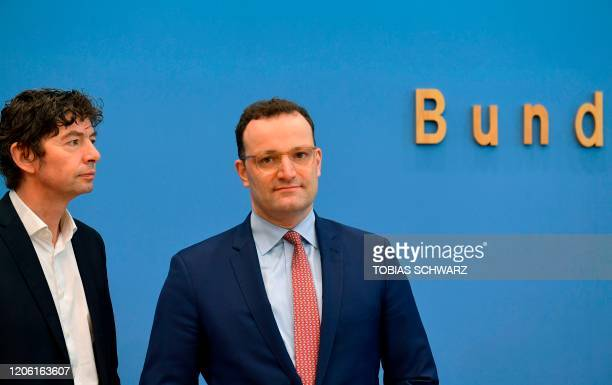 Christian Drosten director of the Institute of Virology at Berlin's Charite hospital and German Health Minister Jens Spahn arrive to give a press...