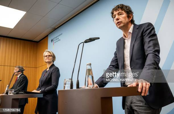 Christian Drosten director of the Institute of Virology at Berlin's Charite hospital Germany Minister for Education and Research Anja Karliczek and...