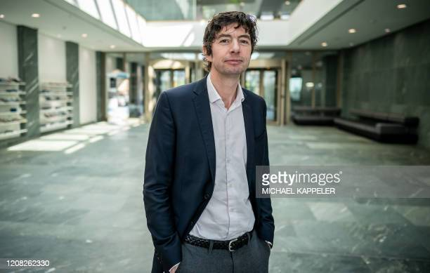 Christian Drosten director of the Institute of Virology at Berlin's Charite hospital poses after a press conference in Berlin on March 26 to comment...