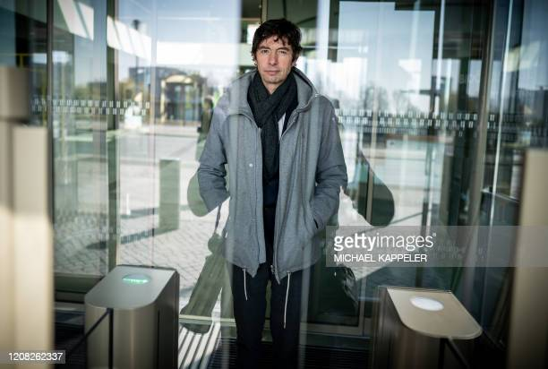Christian Drosten director of the Institute of Virology at Berlin's Charite hospital leaves after a press conference in Berlin on March 26 to comment...