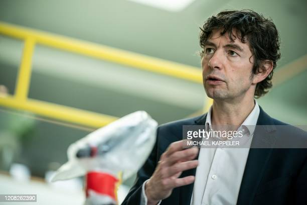 Christian Drosten director of the Institute of Virology at Berlin's Charite hospital is pictured after a press conference in Berlin on March 26 to...