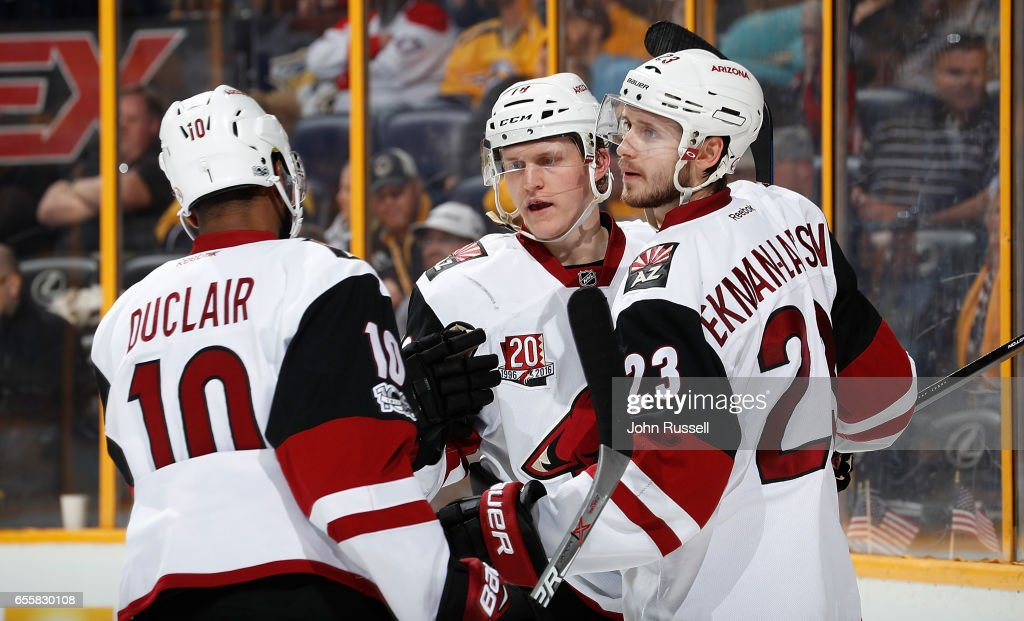 Christian Dvorak #18 of the Arizona Coyotes celebrates his goal with Anthony Duclair #10 and Oliver Ekman-Larsson #23 against the Nashville Predators during an NHL game at Bridgestone Arena on March 20, 2017 in Nashville, Tennessee.