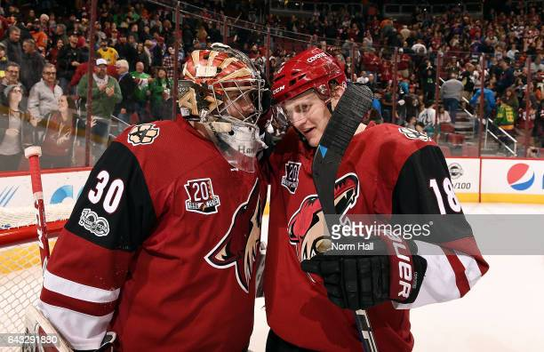 Christian Dvorak of the Arizona Coyotes congratulates teammate Marek Langhamer after a 32 victory against the Anaheim Ducks at Gila River Arena on...