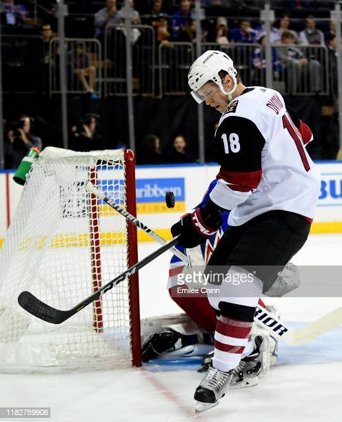 Christian Dvorak of the Arizona Coyotes eyes the puck as he attempts a shot on Alexandar Georgiev of the New York Rangers during the first period of...